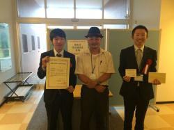 受賞式後の記念撮影。左から中野(現、NJRC)、田代、服部(現、JEC)